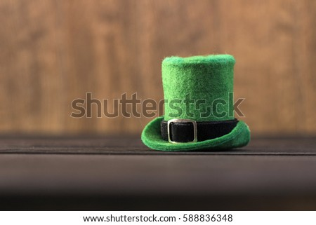 Leprechaun hat green color on wood table. Saint Patrick's Day concept.