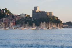 Lerici Castle with the small tourist port. The village of Lerici is located at the end of the Gulf of La Spezia, near the Cinque Terre. The port is home to many sailing and fishing boats.