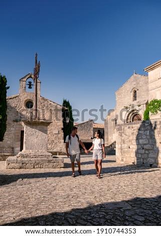 Les Baux de-Provence, Provence, France. couple mid age men and woman visiting old town of Les Baux Stock fotó ©