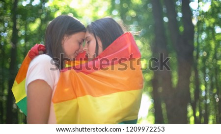 Lesbian couple participate in march for LGBT equality, publicly show feelings