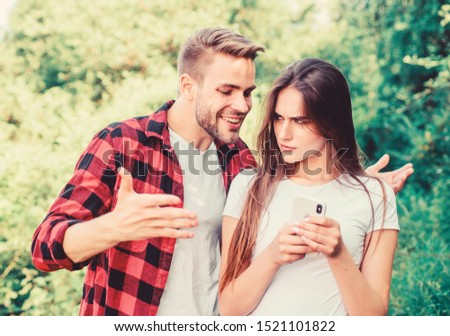 let me see. couple in love. Blogging concept. man pry phone of girl in park. Jealousy. personal space concept. Got lost. navigator search. romantic date online. couple use smartphone outdoor. Сток-фото ©