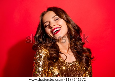 Let's dance all night! Portrait of stylish, trendy lady with closed eyes and modern wave hairdro isolated on bright red background make big white hollywood smile #1197641572
