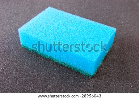 Let\'s make it clean: blue sponge isolated on grey