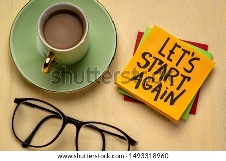 let us start again motivational reminder note with a cup of coffee, determination and tenacity concept Stock photo ©