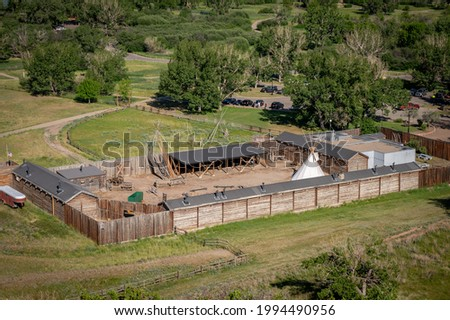 Lethbridge's Fort Whoop-up in summer with rail viaduct in the background. Stock photo ©