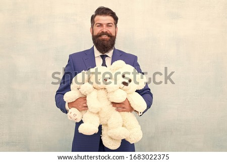 Lets play all day. Happy businessman play with soft toys. Childhood play. Playing games. Toy shop. Gift store. Designed for children or grown-ups. Work hard play harder.