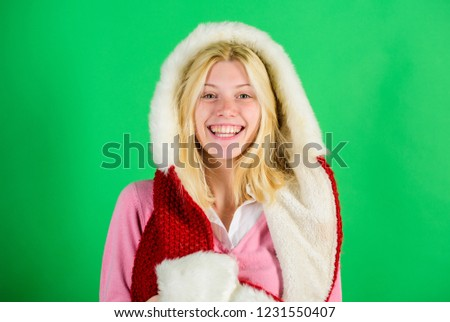 Lets stay warm in fur clothing. Woman emotional face posing in warm furry hood. Girl cheerful blonde warming up wear fur hood on green background. Winter time for cozy warm accessories.