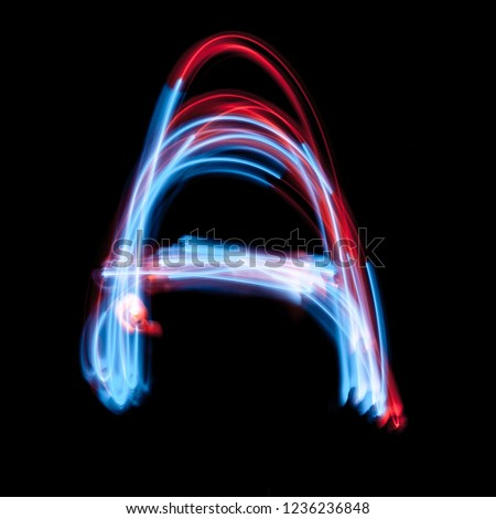 Letter A of the alphabet made from neon sign. The blue light image, long exposure with colored fairy lights, against a black background #1236236848
