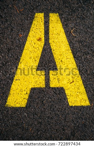 Letter A on asphalt road, top view #722897434