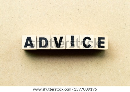 Letter block in word advice on wood background