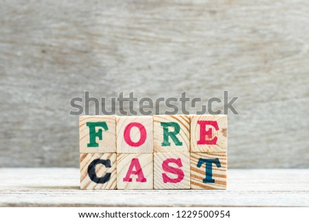 Letter block in word forecast on wood background #1229500954