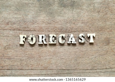 Letter block in word forecast on wood background #1365165629