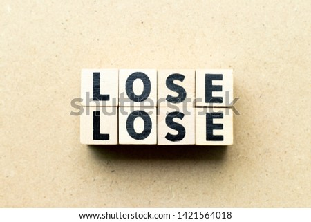 Letter block in word lose lose on wood background (Concept for game theory)