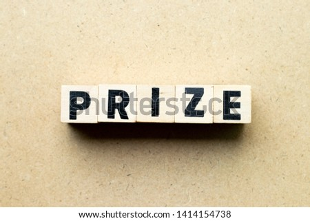 Letter block in word prize on wood background #1414154738