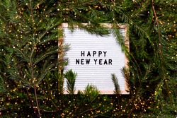 Letter board new year and christmas concept. Top horizontal view copyspace christmas decorations and fur tree.