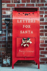 Letter box for Santa. Red box for letters to Santa Claus. Santa Claus letterbox close up.