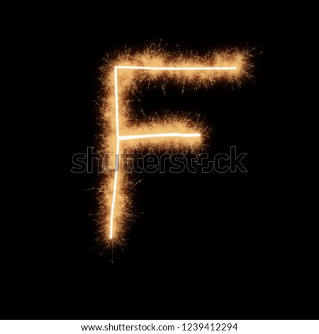 d00306fb67eb9 Letter F of alphabet written by squib sparks on a black background.  #1239412294