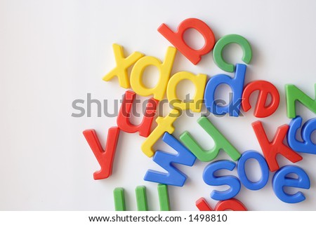 letter fridge magnets in a mess with copy space - stock photo