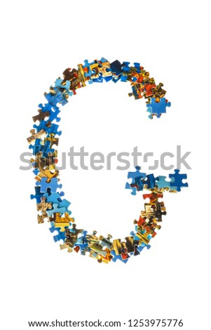 Letter G made of puzzle pieces isolated on white background #1253975776