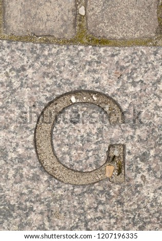 Letter G. On stone background #1207196335