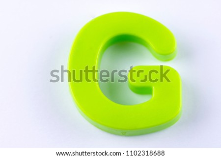 letter G uppercase alphabet isolated made of plastic on white background with shadows #1102318688