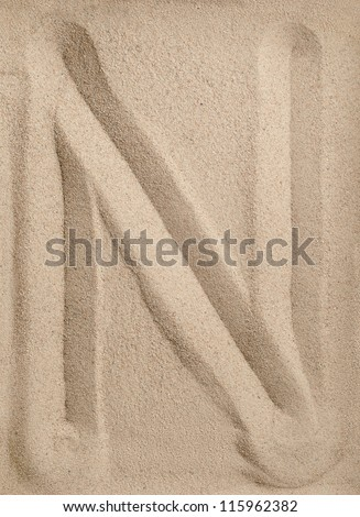 Letter N of the alphabet writing on the sand