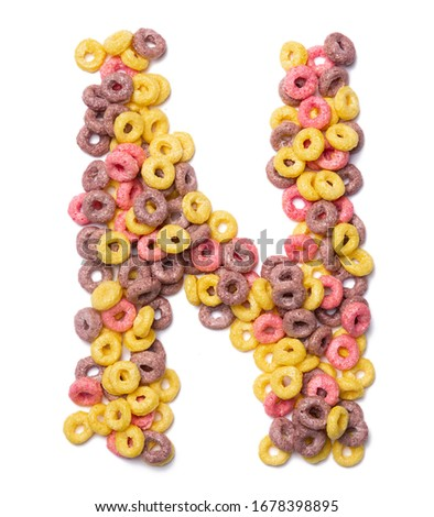 Letter N of the English alphabet from pink colored flakes on a white isolated background. Food pattern made from  sweet breakfast cereals. Bright alphabet for kids shops.    Foto stock ©