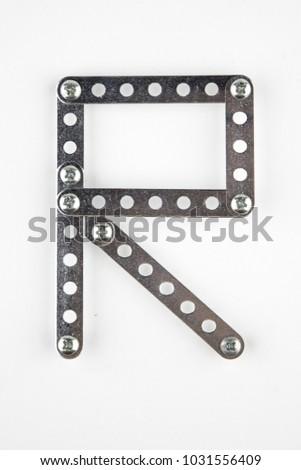 Letter R from the English alphabet of Children's metal designer kit Stock fotó ©