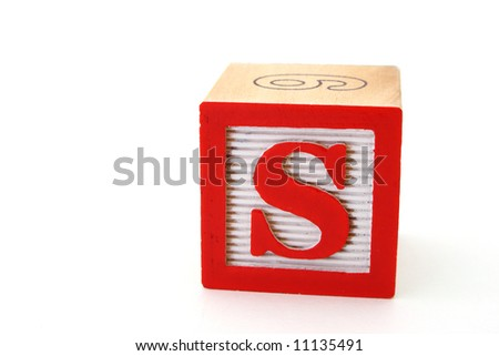 letter s in a alphabet wood block on a white surface