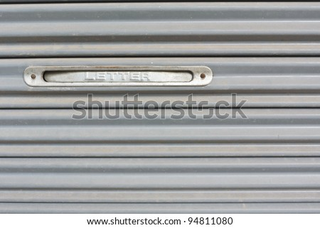letter slot on metal stripe pattern