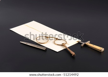 Letter with knife and spectacles