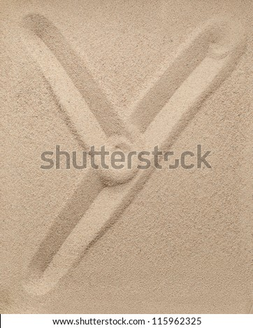 Letter Y of the alphabet writing on the sand