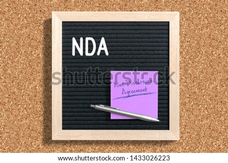 """Letterboard with acronym NDA for """"non disclosure agreement"""" on cork background #1433026223"""