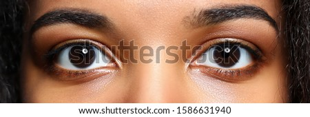 Letterbox view of black woman eyes close-up Stock photo ©