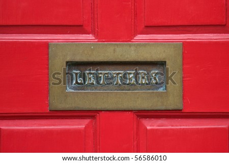 Letterbox with a red door background