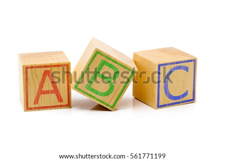 Letters A, B, C imprinted on three brown wooden cubes lined up in a row over white background