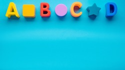 letters abcd on a blue background. layout. children's background