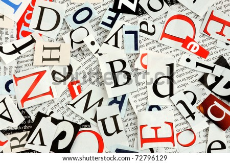 letters cut from newspaper, background