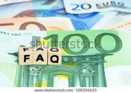 Letters FAQ in wooden letters on Euro currency