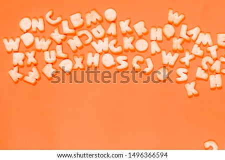 Letters fonts from cookies on orange background. Bakery font. #1496366594