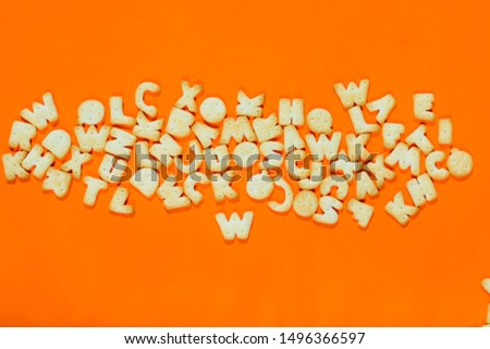 Letters fonts from cookies on orange background. Bakery font. #1496366597
