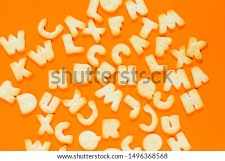 Letters fonts from cookies on orange background. Bakery font. #1496368568