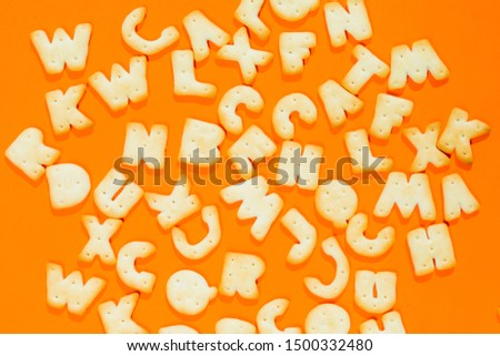 Letters fonts from cookies on orange background. Bakery font. #1500332480