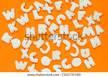 Letters fonts from cookies on orange background. Bakery font. #1502735180