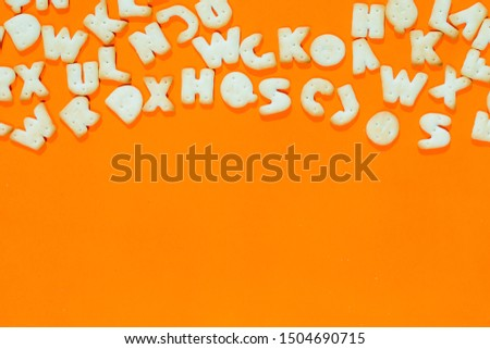 Letters fonts from cookies on orange background. Bakery font. #1504690715