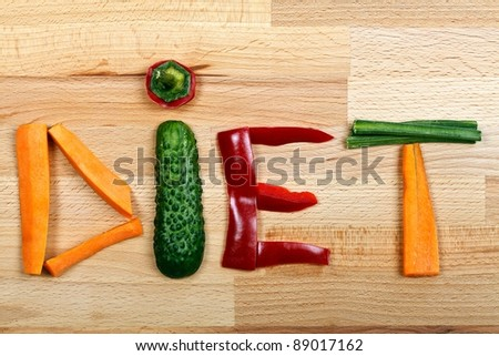 Letters of vegetables on a wooden table, diet concept