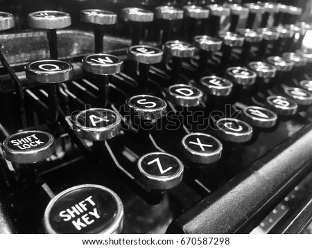 letters on the keys of an old...