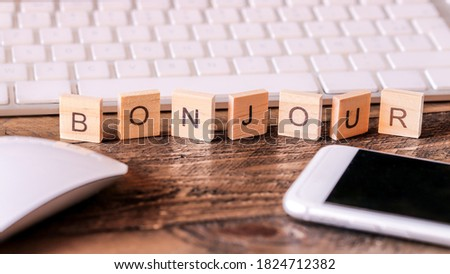 Letters on wooden pieces concept, business background, french word 'Bonjour' means Hello Photo stock ©