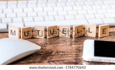 Letters on wooden pieces concept french word means mutual health business background