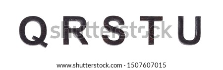 Letters Q R S T U of the English alphabet laser-cut out of wood and charred, burned to the state of coal, the real letter isolated on a white background Stock fotó ©